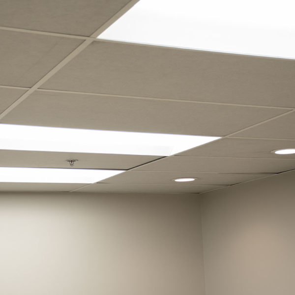 white acoustic ceiling tiles installed in an office