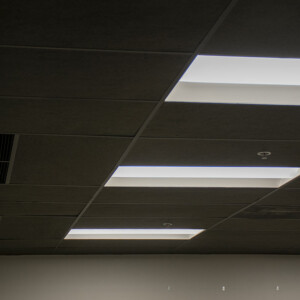 Black acoustic ceiling tiles installed