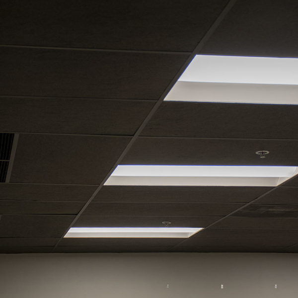 Black acoustic ceiling tiles installed