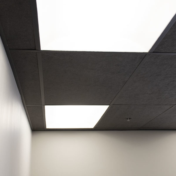 black acoustic ceiling tiles installed in office